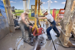 men working on drilling
